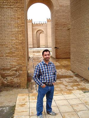 A man stands in a sandstone fortress