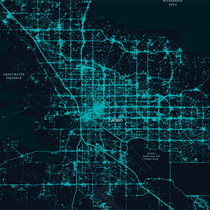 Map of Tucson, Arizona, in black with road traffic overlaid in blue