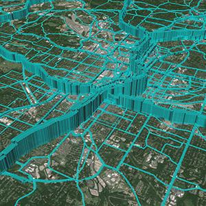 Detail of a simulation program's output, with blue lines of varying heights superimposed on a satellite map of a city