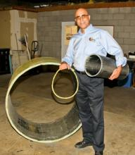 QuakeWrap president Mo Ehsani, professor emeritus of civil engineering at the UA, demonstrates carbon laminate honeycomb pipe sections of various sizes built at his facility in Tucson, Ariz.