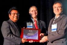Tribikram Kundu, left, receives his prize from SPIE symposium chair Norbert Meyendorf, right, and symposium co-chair Victor Giurgiutiu of the University of South Carolina, center.