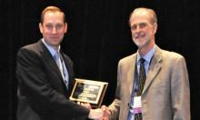 Jim Lozier accepts the 2016 Water Quality Person of the Year award from the American Membrane Technology Association and American Water Works Association. Photo courtesy of AMTA and AWWA.