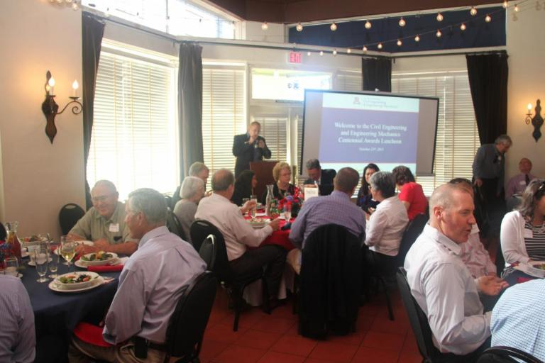 Nathan Palmer introduces the Centennial Awards Luncheon presentation.