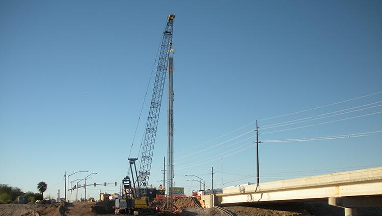 Placing the reinforcing cage in the drilled shaft for the La Cholla Boulevard bridge over the Canyon Del Oro Wash.