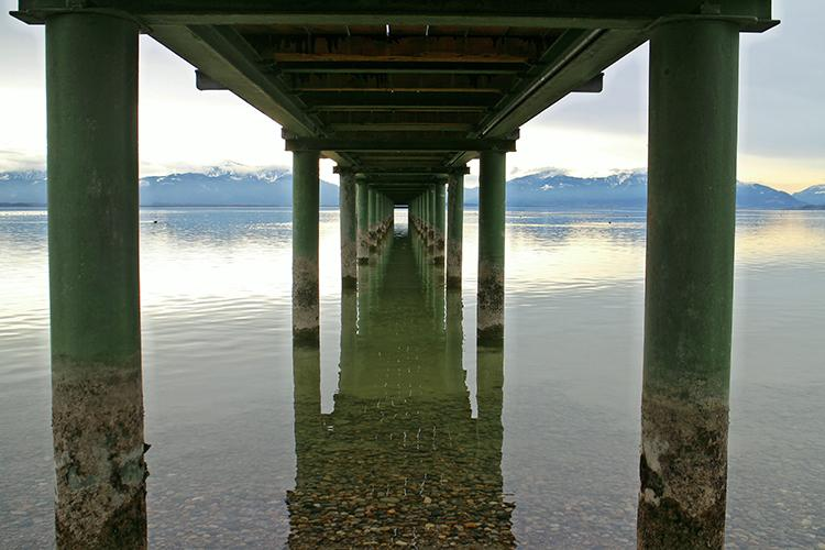 A view under a pier, with supports on either side