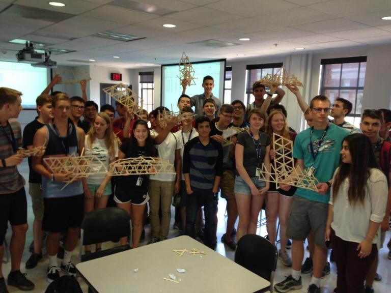 Participants of the Summer Engineering Academy pose with their Popcicle stick bridges.